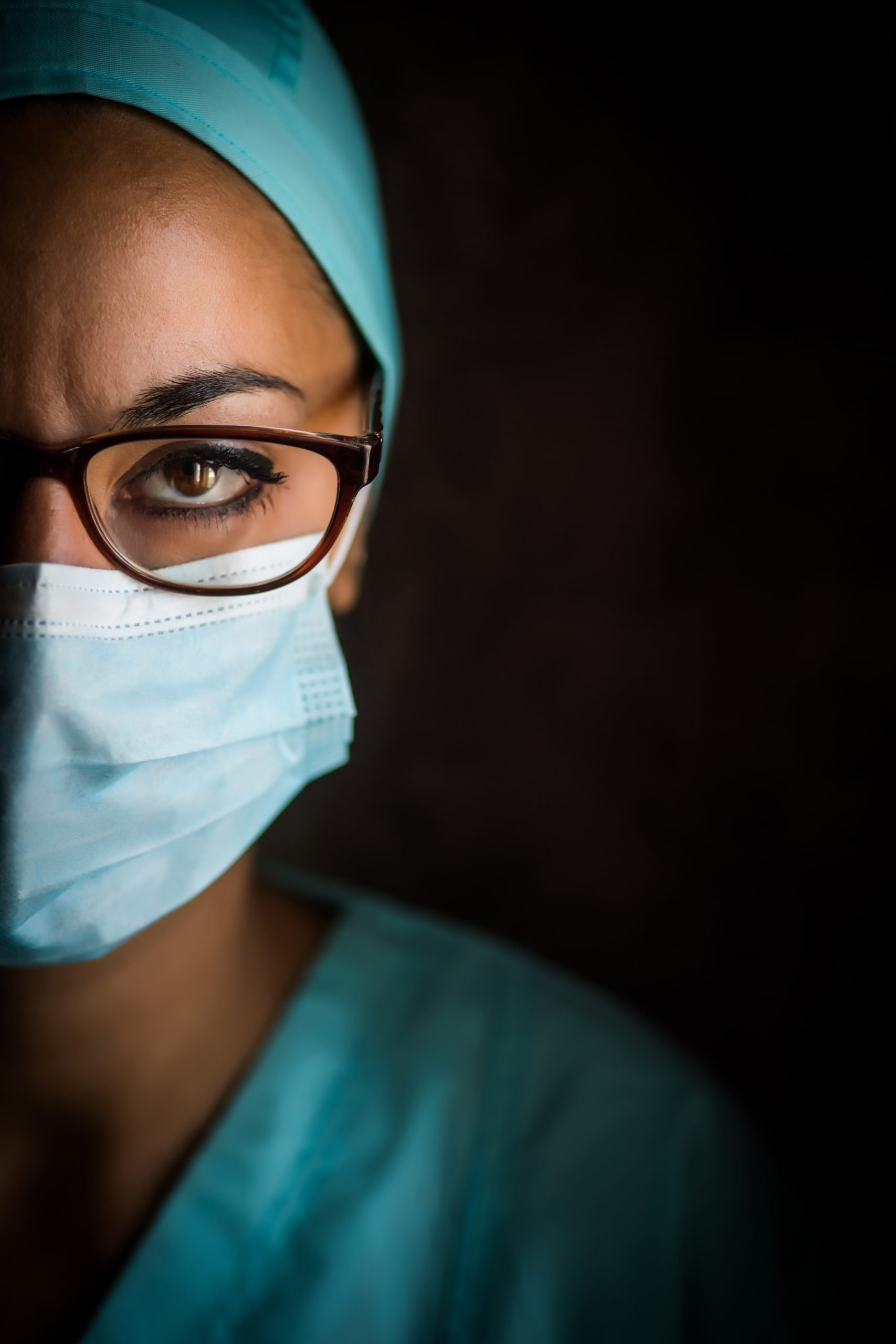 brown skinned woman in medical suit